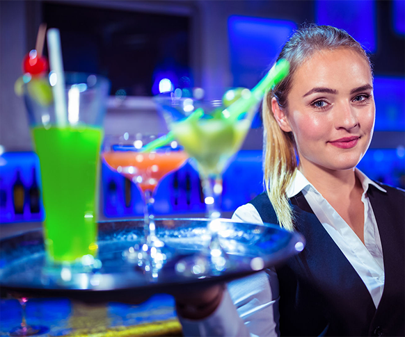 cocktail waitress carrying drink tray